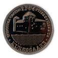 Parvlaevale Regula ja Kuressaare linnuse suveniiriletile on müüki jõudnud messingist ülekullatud Kuressaare linnuse kujutisega meenemünt, mille idee sai mandrimees Ülo Kasema Strasbourg'i katedraalist. Münt valmis Kasemal koostöös riiklike teenetemärke tegeva Roman Tavast OÜ-ga.